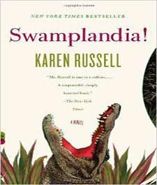 کتابی با جلد سفید رنگ با تصویر سر یک تمساح با دهان باز بر روی آن